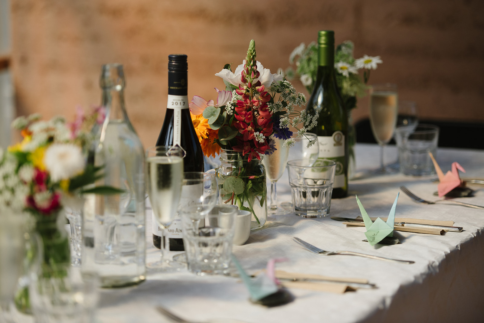 Wedding tablescape with Cornish wild flowers and paper cranes