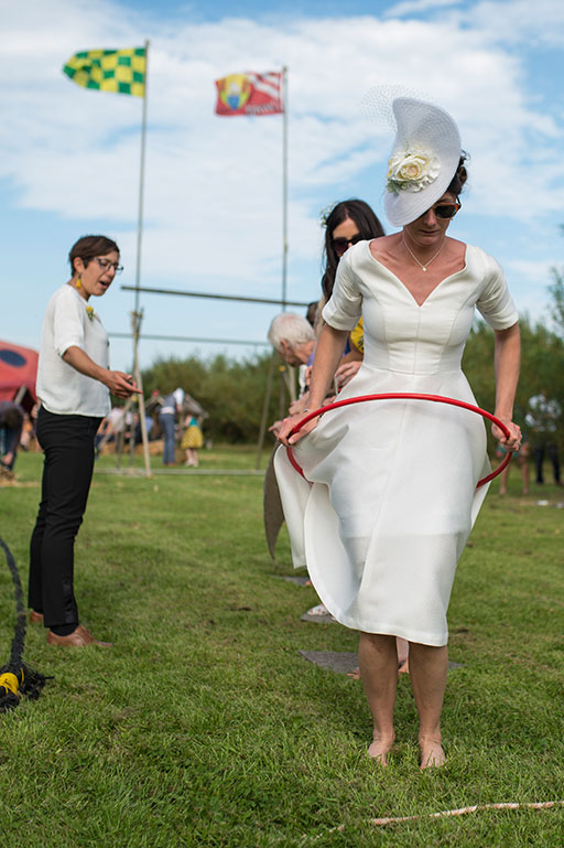 Bride having fun on wedding day lawn games