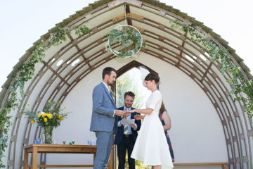 Bride and groom saying their vows at Eco Park wedding