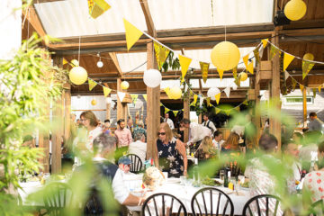 Colourful yellow bunting and lanterns wedding decoration