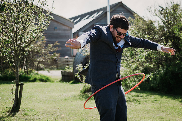 Man having fun in suit on wedding day in sunshine