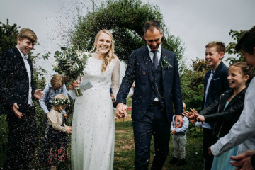 Smiling and happy bride and groom on wedding day in Cornwall