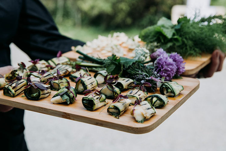 vegetarian courgette wedding canapes on wooden board