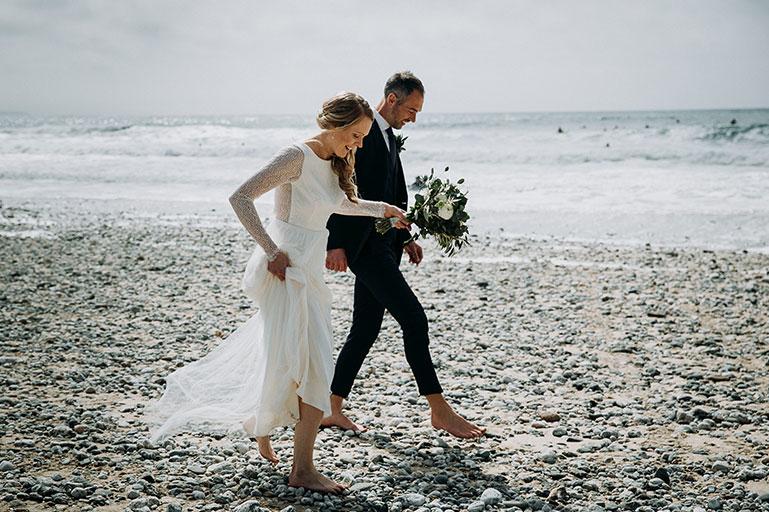 Bride and Groom on Porthtowan beach on wedding day in Cornwall