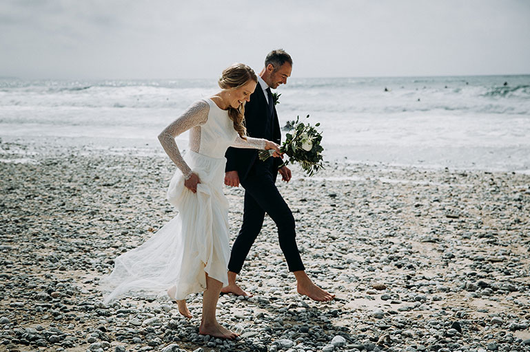 Bride and Groom on Porthtowan beach on wedding day in Cornwall