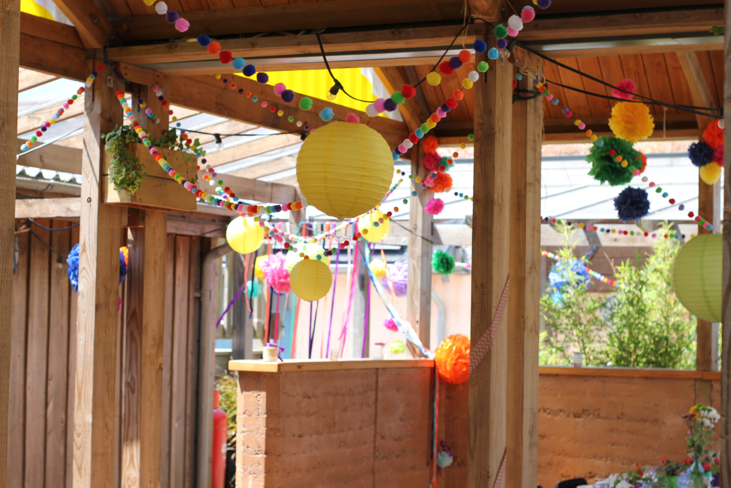 Colourful pom pom garlands and lantern wedding decoration at Eco Park wedding venue