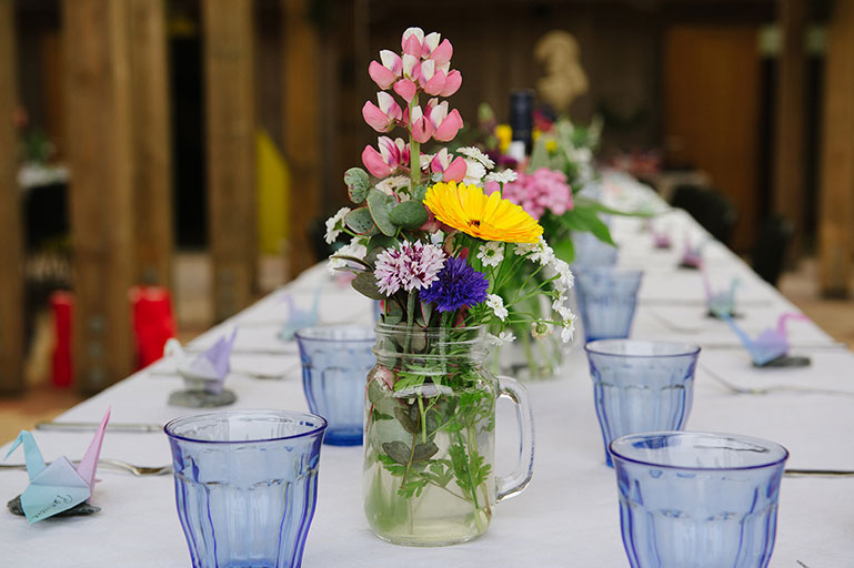 Wedding feast tablescape with vintage blue glasses and cottage garden Cornish flowers