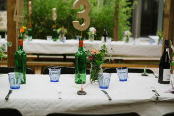 Wedding tablescape with blue glasses and flowers