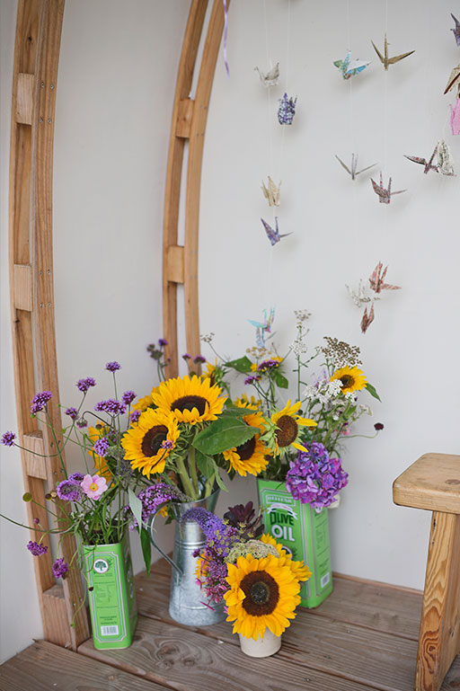 Yellow sunflowers and paper cranes wedding decoration