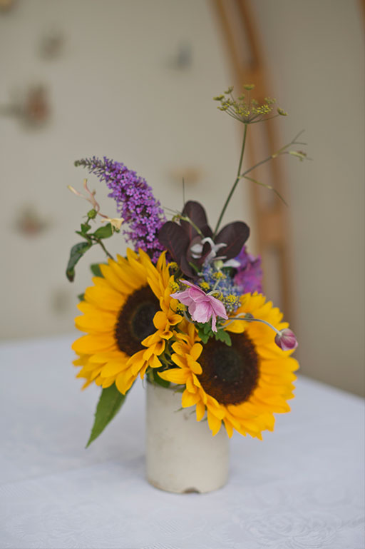 Yellow sunflowers and purple flowers in vintage vase wedding
