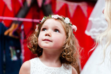 Little girl in white dress at wedding reception