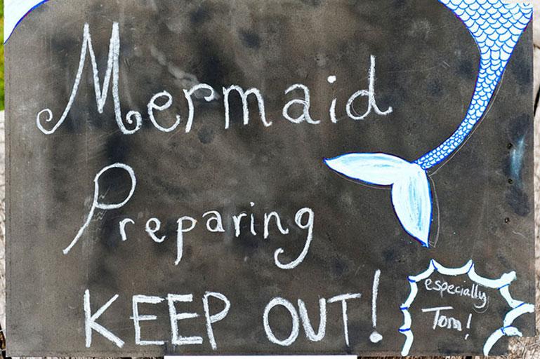 Mermaid preparing keep out sign