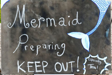 Mermaid preparing keep out sign