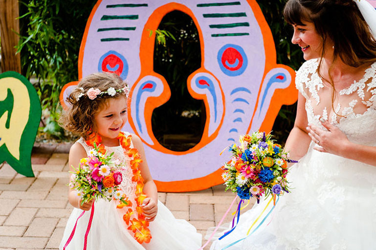 Bride and flower girl with flowers