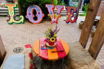 Circus colourful wooden love letters at Eco Park wedding